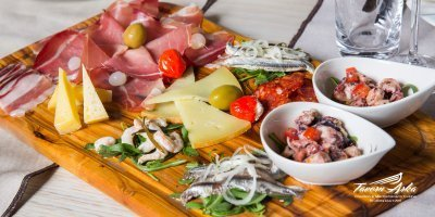 Arka platter anchovies prawns cheeses prosciutto sausage steak closeup
