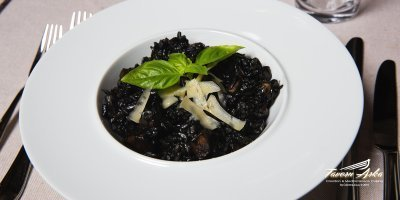 Black cuttlefish risotto serving closeup tavern arka zaton dubrovnik