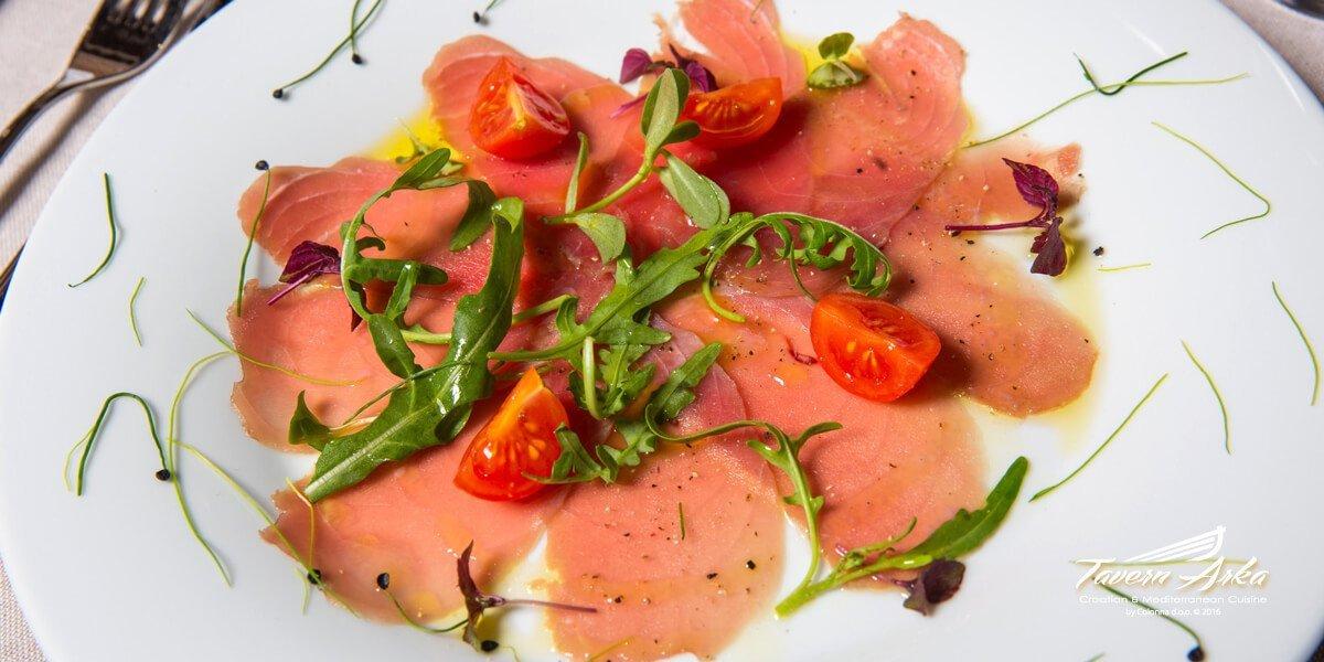 Tuna carpaccio arugula cherry tomatoes closeup tavern arka zaton dubrovnik